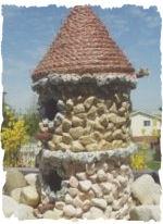 Stone birdhouse with twine roof.