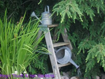 Creative and Frugal DIY Garden Art Projects: Watering can fountain
