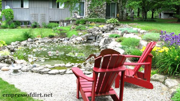 Red Chairs by Garden Pond