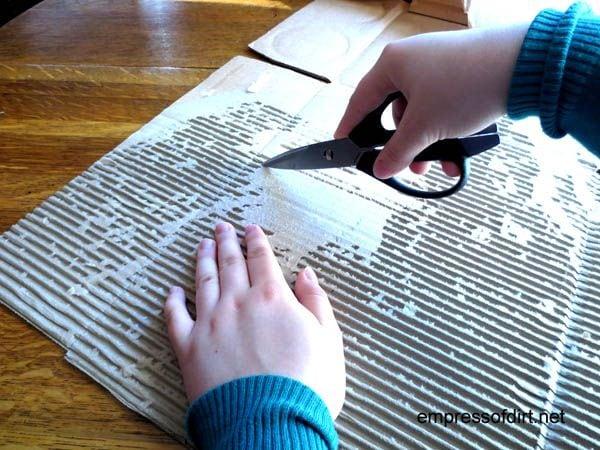 Scoring corrugated cardboard for a owl craft project at www.empressofdirt.net