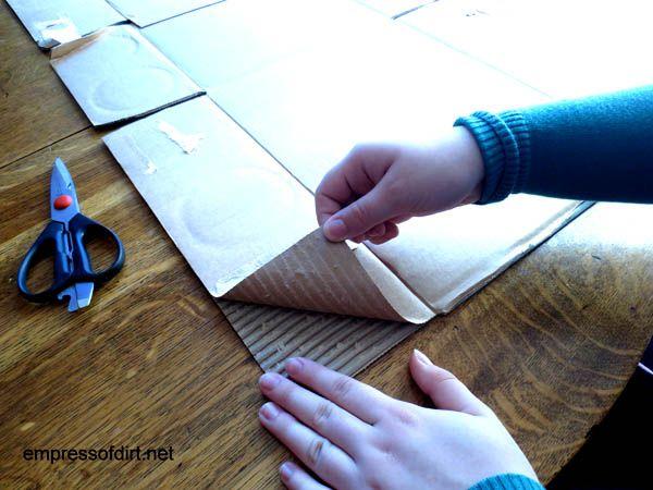 Separating cardboard to make a craft owl at www.empressofdirt.net