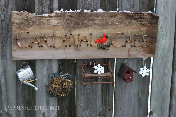 Cardinal Cafe garden art sign with decorations