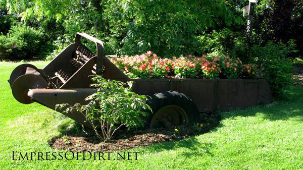 Creative DIY garden container ideas - Old farm equipment planted with flowers