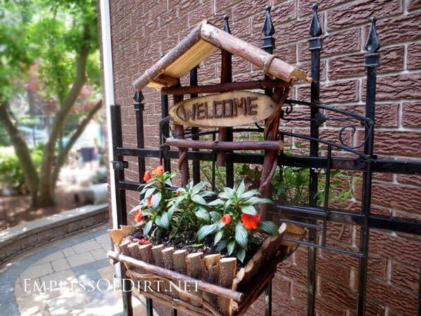 Creative DIY garden container ideas - Planter made of twigs on iron gate