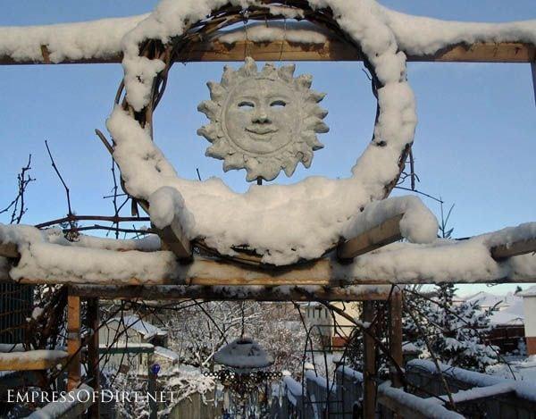 Sun face garden art in the winter garden